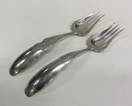 A large pair of Dutch silver engraved forks with p