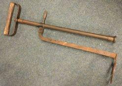 A vintage Stirrup Pump. Est. £5 - £10.