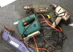 A Collection of Power Tools to include two electric drills, a planer and a Black & Decker jigsaw