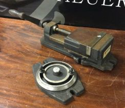 A Vertex Precision Milling Machine Vice with swivel base. Est. £100 - £150.