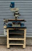 A Chester Milling Machine mounted on industrial workshop table. Est. £400 - £500.