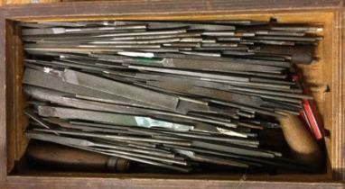 A wooden box containing assorted files of varying sizes. Est. £10 - £20.