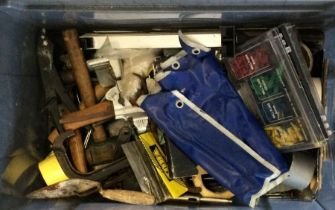 A box containing assorted tools comprising various hammers and a drill