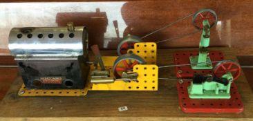 A model of Stephenson's Rocket on wooden base. Est. £10 - £15.