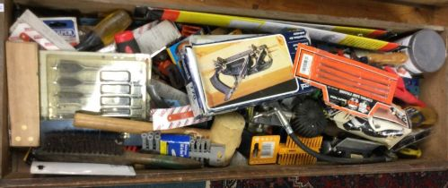 A tray containing assorted woodworking tools comprising planes,