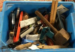A box containing assorted tools comprising a small vice,