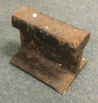 A small cross-section of old-type railway track. Est. £5 - £10.