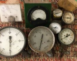 A wooden box containing assorted gauges to include a rare