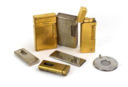 A smoking group including a Dunhill lighter, two Dupont lighters etc.