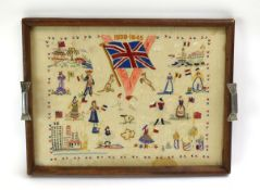 A Second World War Victory embroidery contained within a 1950's glazed tea tray