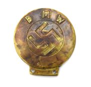 A Second World War-pattern BMW brass car badge