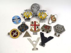 A group of car badges including AA, Pegasus Motor Club, RAC etc.