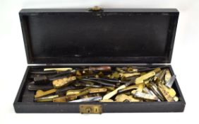 A black case containing an extensive group of 19th century phlebotomy blood letting tools,