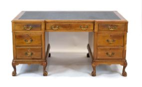 A Queen Anne-style breakfront desk,