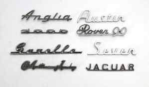 Eight chromed car name plates including Gazelle, Rover 90, Seven, Austin, Anglia, Austin-Healey,