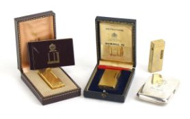Two cased gold-plated Dunhill lighters together with a similar lighter and a silver-plated