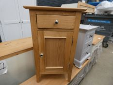 Oak single door cupboard with drawer (57)