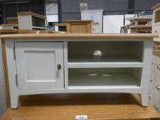 Small white painted oak TV audio unit with single cupboard and 2 shelves under (56)