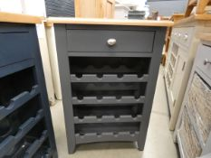Blue painted oak wine rack with single drawer under (14)
