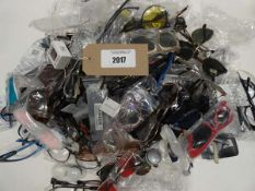 Bag containing large quantity of loose reading glasses and sunglasses