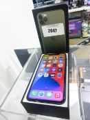 Apple iPhone 11 Pro Max in midnight green. 64Gb mobile phone with charger, charging cable, earphones