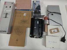Bag containing Logik TV bracket and power kit, Loewe multi room receiver, wireless microphone,