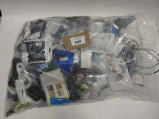 Bag containing quantity of mobile phone accessories; cables, leads, adapters, earphones, power bank,