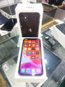 Apple iPhone 11 in black. 64GB mobile phone. Comes with charger, earphones and box