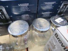 3 Mason tilted glass jars