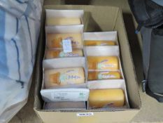 Box containing 3 packs of 4 pillar candles