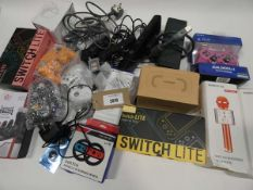 Bag containing quantity gaming accessories; controllers, PSUs, cables, cases, etc