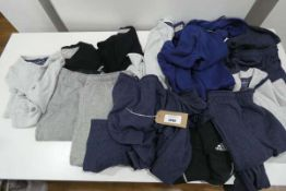 Bag containing mens jogging and sleep wear including Adidas hoodie and Eddie Bauer sleep wear in