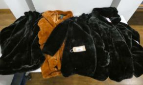 4 ladies faux fur coats to include DKNY and Andrew Marc, 3 in black and 1 in rusty brown, the 3