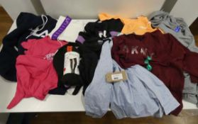 Bag containing mixed ladies clothing including Champion tops, Fila hoodie, DKNY top, Jessica Simpson