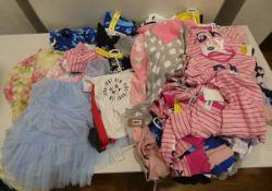 Bag of childrens mixed clothing including sleepwear, rainwear and leisure wear