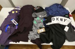 Bag of ladies mixed clothing to include Fila jogging trousers, DKNY and Champion, mixed sizes and