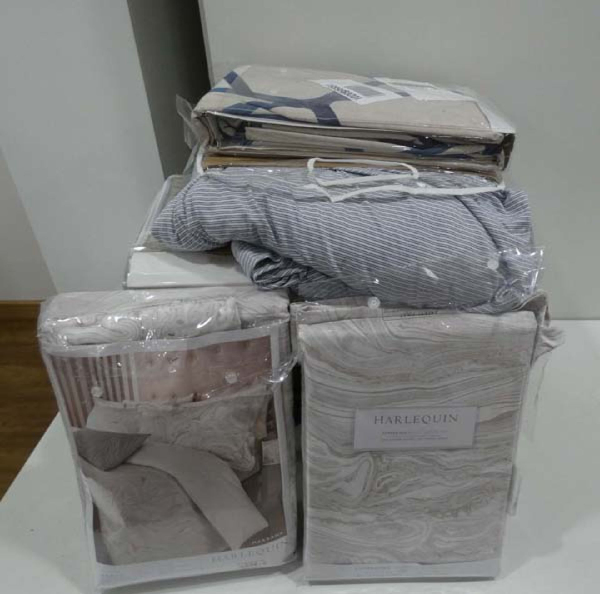 Large quantity of bed linen and duvet sets in various sizes and colours