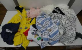 Bag of childrens clothing including rain wear, sleep wear and dresses in mixed sizes and colours