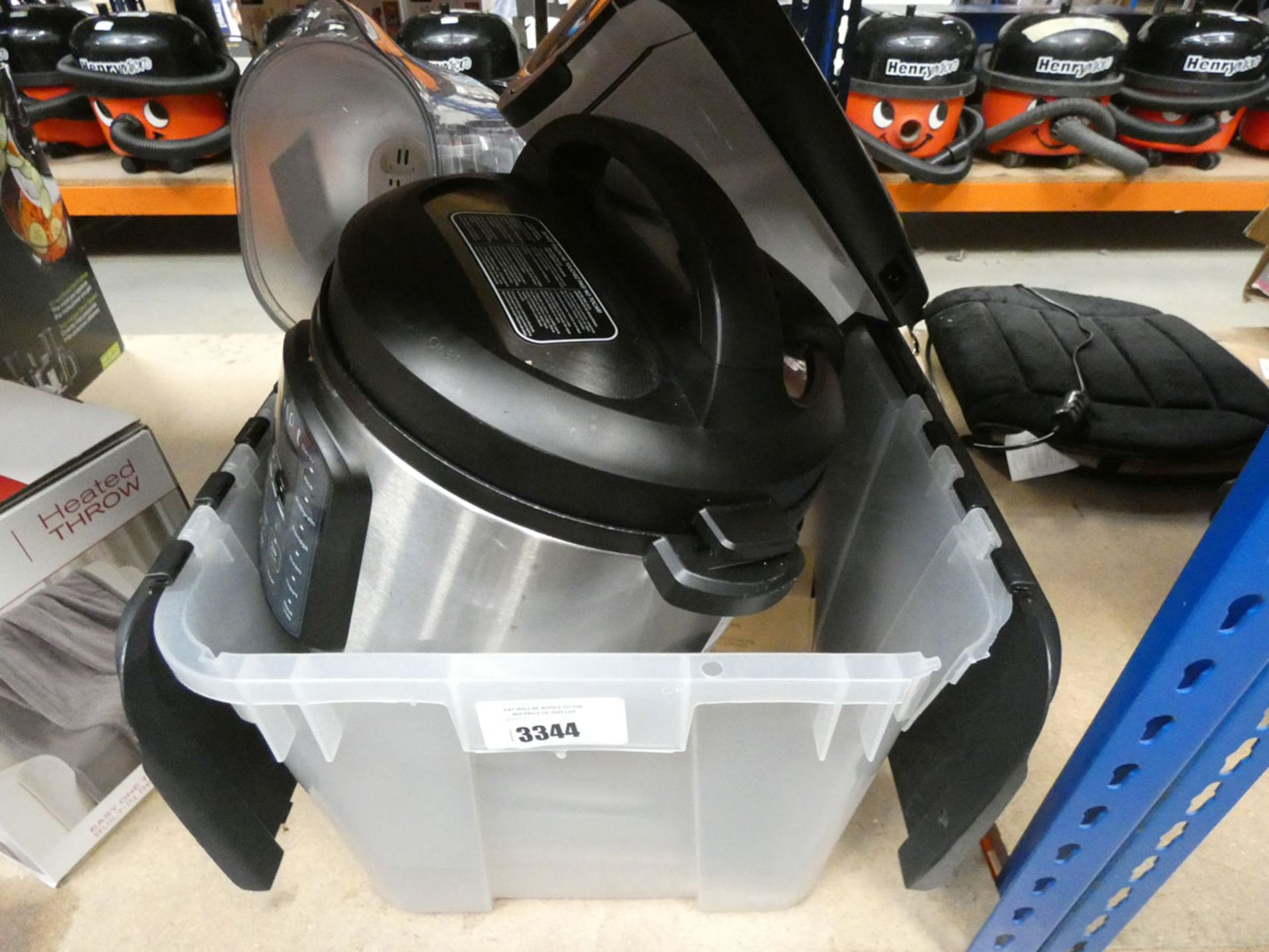 Box containing a Instant Pot, Easy soup maker, etc