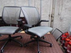 2 Humanscale black frame and grey mesh seat pad and back support swivel office armchairs