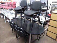 200 cm oval meeting table in black on chrome legs with a set of 9 matching charcoal cloth stacking