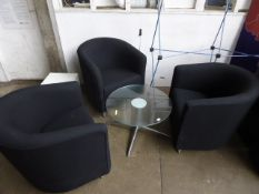 3 Orange Box black cloth tub chairs with a low circular glass top coffee table