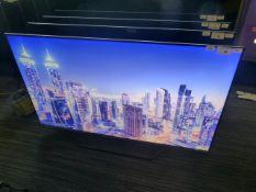 R12, 55'' Hisense 4K UHD TV, model 55U7QFTUK, to include box no. B90