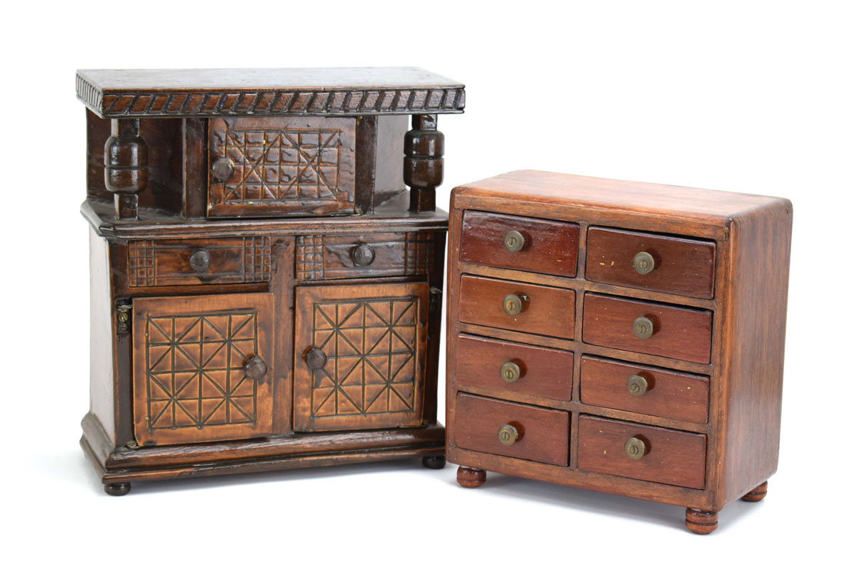 Miniature Furniture: a court cupboard, h. 27 cm, together with an eight-drawer cabinet, h.