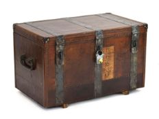 A 19th century metal bound trunk with leatherwork and brass studwork, the interior painted green,