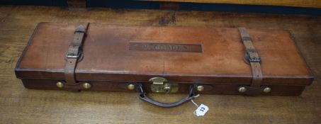 A tan leather and brass mounted gun case, inscribed V. Cobden, l.