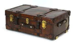 A late 19th century tan leather and brass mounted luggage case/trunk,