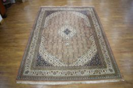 A 20th century carpet, the central medallion with a pale pink and sage ground,