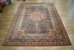 A 20th century carpet with a red ground and floral sprays,