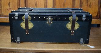 A small French travelling trunk with leather and brass bindings, the brass name plate inscribed R.